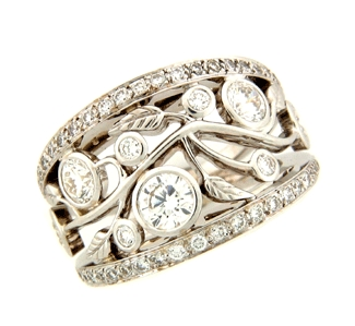 Shown here in 14K White Gold, this Fashion Ring contains 1.53 ct. of Diamonds.