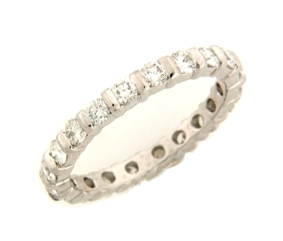 Shown here in Platinum, this Wedding Band contains 0.99 ct. of Diamonds.